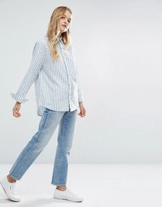 Menswear-inspired basics are essential for every stylish woman's wardrobe. For a casual everyday look, try pairing an oversized button-up with boyfriend jeans and patent-ankle boots. Or, for a more da