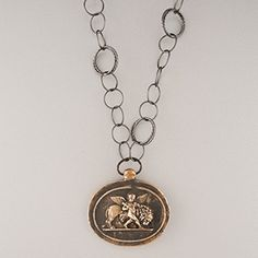 Pyrrha Design Lion and Cherub Intaglio Necklace 36''. Pendant cast in reclaimed bronze from an 18th century intaglio. Handcrafted in Vancouver, Canada.