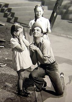 Gene Kelly hamming it up with some kids --from An American in Paris