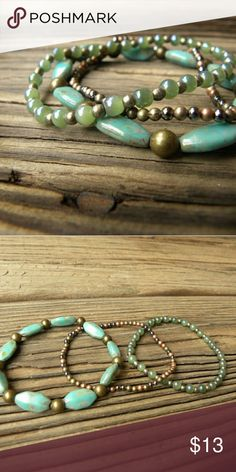Three Elastic Antique Gold and Turqoise Bracelets Antique gold-finished beads and antique faux turquoise beads are the focal point of this three-bracelet set! You'll also find bits of green, silver, and copper throughout. This is a great set to dress up or down. They are made with a strong elastic, making them super easy to take on and off! The variety of colors, shapes, and sizes of the beads makes for a dazzling set! Each bracelet is approximately 6.5 long. Handmade by myself! Jewelry…
