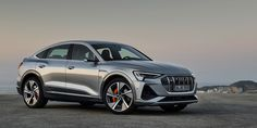 The Audi e-tron comes in 2 models, the Sportback and the SUV. The Sportback is the newest installment of the e-tron line. The e-tron GT is featured as a concept Electric Car Reviews, Electric Cars, Suv Cars, Sport Cars, Audi Autos, Automobile, Sports Car Wallpaper, Car Salesman, Car Shop
