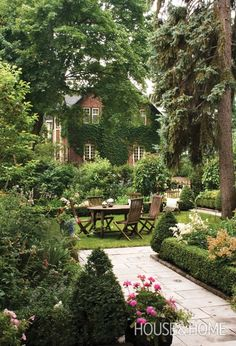 """Borrow a few ideas from this gorgeous #backyard in Montreal. Gardening guru Marjorie Harris loves the idea of a path that leads to an open """"tapis vert,"""" or green carpet. Line the path with boxwood hedges and a mix of annuals and perennials, and surround the """"carpet"""" with taller bushes and trees for privacy. Invest in a rustic wooden dining set and let the summer entertaining begin!   Via Canadian House & Home"""
