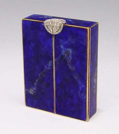 14k ART DECO DIAMOND LAPIS AND ENAMEL BOX: Retailed by Brand - Chatillon of New York. 14K yellow gold box with platinum clasp The outer side of the box is covered with lapis veneers.  The platinum clasp contains forty one round rose cut diamonds.  The diamonds are bead set. The spring hinge double doors open to reveal a lid with a red and gold Japanned scene
