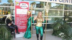 Sexy women with tritons hanging out next to Red Route sign, San Diego Comic Con 2015 | Photo by Patty Mooney of Crystal Pyramid Productions in San Diego - sandiegovideoproduction.com/video-producers/patty-mooney/