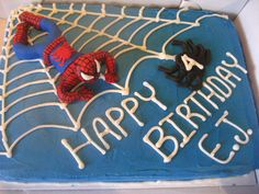 Spiderman cake - Cake is frosted with a crusting buttercream. Spiderman and spider are made entirely out of fondant.