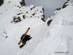 Mark Cavaliero climbing to ski Kit Carson.