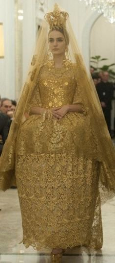 D & G are killing it this season! Now I just need to find an occasion where it's suitable to wear a gold Byzantine bridal gown, complete with veil and crown. >>> Dolce & Gabbana S/S 2013.