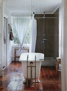 wood floors in the bathroom and a clawfoot tub in the middle! to die for!