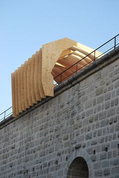 This tunnel made up of wooden profiles was designed by NAS Architecture to arch over the fortifications surrounding a historic commune.