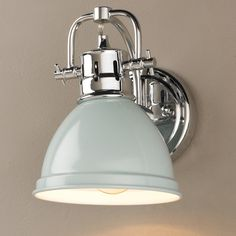 Classic Dome Shade Bath Sconce A simple yet classic style in vibrant and traditional colors. This 1 light sconce will add a crisp clean look to your home. A great choice for traditional, beach, cottage, or contemporary decor. Hardware is available in three finishes: Bronze and Chrome or Pewter with your choice of metal enameled shades in Black, Blue, Red, Seafoam, and White or plated shades in Chrome and Pewter. UL listed Damp location. Can be installed either up or down…