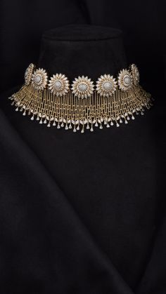 The glamorous AZVA Showstopper with the intricacy of diamonds.You can find Diamond jewellery and more on our website.The glamorous AZVA Showstopper with the intricacy of diamonds. Indian Jewelry Earrings, Indian Jewelry Sets, Jewelry Design Earrings, Indian Wedding Jewelry, Gold Jewellery Design, Bridal Jewelry Sets, Necklace Designs, Diamond Jewelry, Gold Jewelry