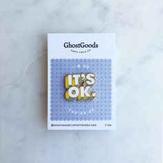 Im OK. Youre OK. Its OK.  Spun-cast pin in shiny gold-tone metal with recessed white, yellow & grey enamel, with white rubber clutch.  Approx. 1 x