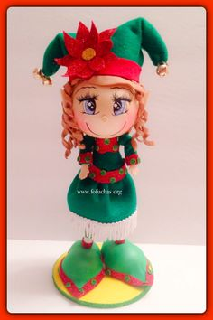 Santa's Little helper. Girl fofucha Doll. Doll is made using foam sheets. She stands 10inches tall. 100% handmade. Can be a perfect Holiday decoration/centerpiece, can also make a great one of a kind gift! To order visit fofuchas.org like us and see more at facebook.com/fofuchashandmadedolls  #Elf #Christmas #fofuchas