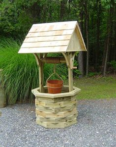 How to build a wooden wishing well. or 6 ft. wishing well. Large wishing well has a cedar shingle roof. Wishing Well Garden, Wishing Well Plans, Diy Garden Projects, Outdoor Projects, Wood Projects, Outdoor Decor, Gazebos, Front Yard Design, Diy Bird Feeder