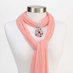 Two Color Mosaic Scarf Jewelry Pink.  http://www.purpleboxjewelry.com/products/scarf-jewelry/two-color-mosaic-scarf-jewelry-pink.html This pendant scarf jewelry is a two color mosaic of pink and coral stones hanging from a banded ring. It is the perfect piece to brighten any outfit. Scarf not included. Scarf not included.