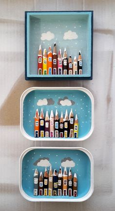 little villages made with pencils in small fishcans