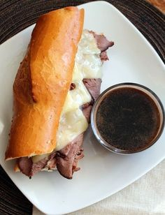 This is the best damn French Dip Sandwich on Earth!! The french dip, in my opinion, is the crowning jewel of sandwiches. The savory roast beef, the mild cheese, with the perfect bakery fresh bun conquers the tastebuds. And don't forget the au jus for dipping!