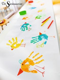 With finger paints and crayons, funny little birds on cardboard, paper . - With little fingers and crayons, funny little birds are painted on cardboard, paper tablecloths or - Paper Tablecloth, Diy And Crafts, Crafts For Kids, Cardboard Paper, Finger Painting, Little Birds, Colorful Decor, Decorative Accessories, Colored Pencils