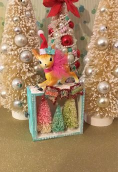A personal favorite from my Etsy shop https://www.etsy.com/listing/538209702/vintage-kitschy-christmas-decoration