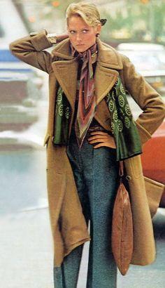 Photo by Arthur Elgort. Vogue 1974 the camel coat 70s casual elegance pants trousers jeans tan blue scarf purse model magazine vintage fashion style