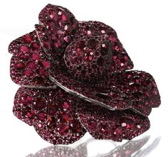 A great example of JAR's use of pavé to nearly replicate reality in his work. Camellia brooch of rubies and diamonds by JAR, 2003, sold for $4.3M at Christie's Geneva 5/14/12 -- 3x the low estimate and the highest price ever paid for a JAR jewel at auction.