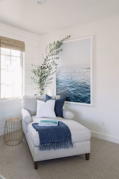 modern coastal family room with shiplap and modern ocean print chaise with blue and white decor seating area in coastal bedroom design Love the chaise the blanket color photo plant window coverings Coastal Family Rooms, Coastal Bedrooms, Coastal Master Bedroom, White Family Rooms, Family Room Colors, Ocean Bedroom, Bedroom Rustic, Family Room Design, Gray Bedroom