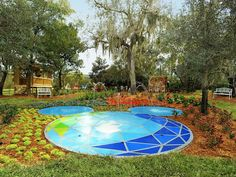 Magical Backyard Makeovers : not in the M.Mouse shape...but, I like the mosaic look of this splash pad.