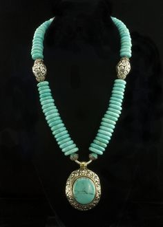 Turquoise Disk Necklace  Genuine turquoise and Tibetan silver necklace.