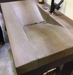 Concrete Countertop concrete sink -looks like wood -From arch digest show JM
