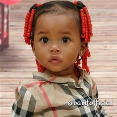 Beautiful baby I like her red beads ,little girls don't dress like little girls anymore. this is so pretty
