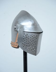 Bascinet Weight: 3.75 Kg Ear to Ear Distance: 17.5 cm Material: Mild Steel Thickness: 3 mm (Skull), 2 mm (Visor) Technique: forging, punching, filing, chiseling Both skull and visor are forged from a single plate of steel, only using a coal forge. Every edge has been chiseled and filed by hand. Every hole has been punched and filed by hand. The vervelles has been forged and filed by hand, but the holes has been (unfortunately) dilled. The surface of the skull has been filed by hand.