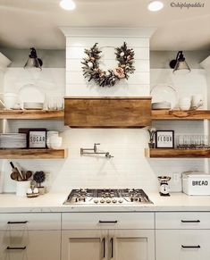 Haus Shiplap hood, whites and woods make for a beautiful farmhouse kitchen. For more farmhouse inspo White Farmhouse Kitchens, Farmhouse Kitchen Decor, Kitchen Redo, Home Decor Kitchen, New Kitchen, Home Kitchens, Shiplap In Kitchen, Kitchen Ideas, Kitchen Stove