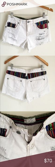 || • FP Aztec Patch Distressed Denim Shorts Amazing white/ivory shorts. It has aztec boho patch work around the waist and on pockets. Distressed look. Free People Shorts Jean Shorts