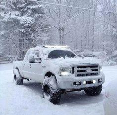 lifted white fordF-250  truck manitoba winter snow