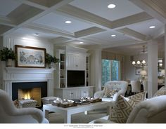 Lovely great room with coffered ceiling, built-ins and fireplace. #greatrooms homechanneltv.com