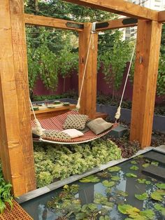 """This intimate space uses rich colors, lush textures and natural materials to inspire relaxation. The curved timber daybed is suspended over a blanket of Pieris japonica overlooking a reflection pond afloat with water lilies and lotus.. Because It's free! """"Like, Comment, SAVES and REPIN"""" for More Funny Images:). Please Visit: usateeshoponline.com Thanks a lot a lot! What do you think about this beautiful photo? Please make a commnet below. Say thanks to you!"""