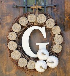 Grapevine wreath with burlap flowers, painted pumpkins and monogram G. Explanation how to make.