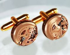 Omega Steampunk Cufflinks - Made with the world's smallest automatic watch movement! Available at Time In Fantasy. $249