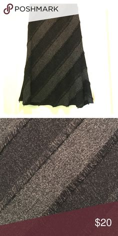 Black and grey fringed skirt Black and grey skirt with fringes.  Full lined with elastic waist. Lena Gabrielle Skirts