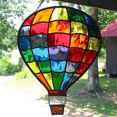 Rainbow stained glass hot air balloon suncatcher handcrafted in the Tiffany method using beautiful Waterglass textured glass made by the Spectrum Glass Stained Glass Suncatchers, Stained Glass Designs, Stained Glass Panels, Stained Glass Projects, Stained Glass Patterns, Stained Glass Art, Mosaic Glass, Fused Glass, Mosaic Mirrors