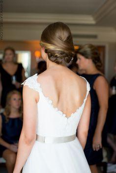 low chignon; woven updo; classic bridal hair.