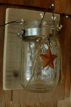 Single Mason jar with Rusty Barn Star on recycled wood rustic wall decor. $15.00, via Etsy.