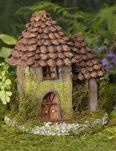 Use the spikes from a pine cone to roof a fairy house.