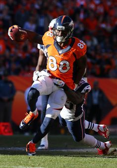 Demaryius Thomas #88 of the Denver Broncos completes a pass for a 15 yard gain in the third quarter against the New England Patriots during the AFC Championship game at Sports Authority Field at Mile High on January 19, 2014 in Denver, Colorado.