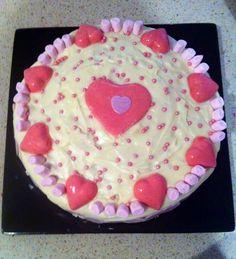 Strawberries and cream cake with chocolate hearts