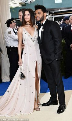 Monday mayhem: The young couple posed together as they walked the white carpet; Selena wore a dress by Coach