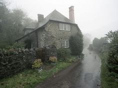 stone house among the green in the fog