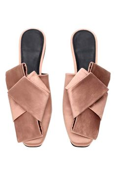 Mules: Satin mules in a silk blend with gently squared toes and a large bow decoration at the front. Leather linings and insoles and rubber soles.