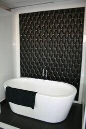 Black leather effect ceramics forming feature wall. Looks just like luxury leather padded wall! Padded Wall, Feature Tiles, Lighting Store, Sunshine Coast, Wall Tiles, Modern Bathroom, Master Bath, Bathtub, Luxury