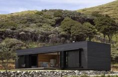 """Residential Architecture: Storm Cottage by Fearon Hay Architects: """".Located on the east coast of Great Barrier Island, New Zealand – a black rough sawn timber box sits looking north to the s… Residential Architecture, Interior Architecture, Interior Design, Design Interiors, Classical Architecture, Casas Containers, Black House, Cottages, Villa"""